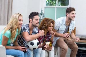 depositphotos_102601328-stock-photo-friends-watching-soccer-match